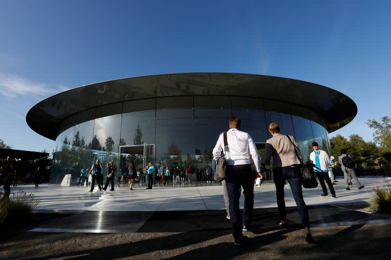 FILE PHOTO: Guests arrive for at the Steve Jobs Theater for an Apple event at their headquarters in Cupertino