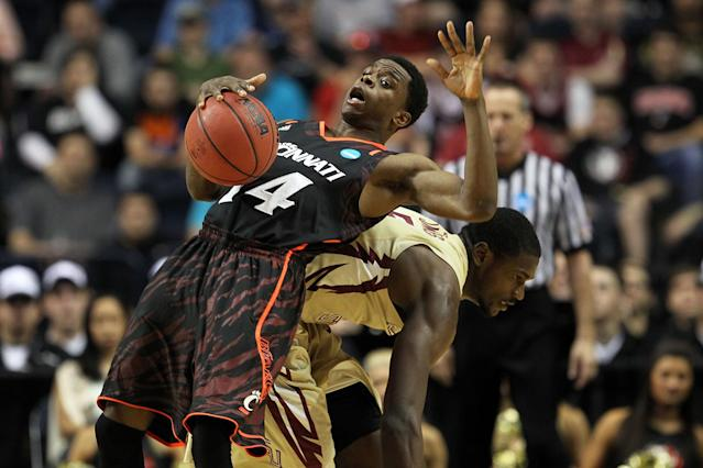 Ge'Lawn Guyn #14 of the Cincinnati Bearcats trips over Bernard James #5 of the Florida State Seminoles during the third round of the 2012 NCAA Men's Basketball Tournament at Bridgestone Arena on March 18, 2012 in Nashville, Tennessee. (Photo by Jamie Squire/Getty Images)