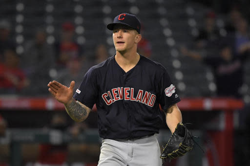 Cleveland Indians starting pitcher Zach Plesac claps after striking out Los Angeles Angels' Matt Thaiss to end the baseball game Tuesday, Sept. 10, 2019, in Anaheim, Calif. The Indians won 8-0. (AP Photo/Mark J. Terrill)