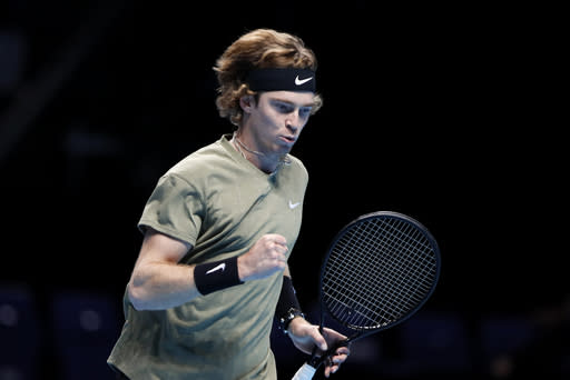 Andrey Rublev of Russia celebrates winning a point against Dominic Thiem of Austria during their doubles tennis match at the ATP World Finals tennis tournament at the O2 arena in London, Thursday, Nov. 19, 2020. (AP Photo/Frank Augstein)