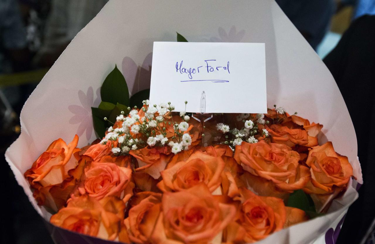 Flowers left for Toronto Mayor Rob Ford are seen after he arrived at City Hall in Toronto June 30, 2014. Toronto Mayor Rob Ford, who shot to prominence last year after admitting to smoking crack, buying illegal drugs and driving after drinking, insisted for months he did not have a problem. But last month he said he would take time off to deal with his drinking issues in rehabilitation and has now returned to office. REUTERS/Mark Blinch (CANADA - Tags: POLITICS CRIME LAW DRUGS SOCIETY)