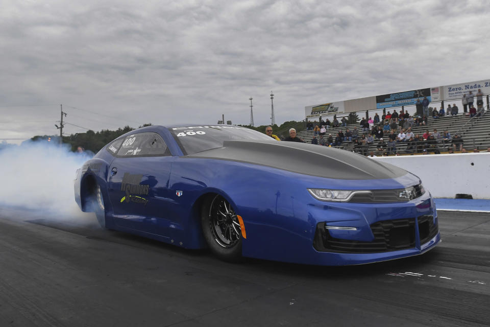 In this photo provided by the NHRA, Pro Stock newcomer Mason McGaha drives in qualifying Friday, June 11, 2021, at the NHRA New England Nationals drag races in Epping, N.H. (Marc Gewertz/NHRA via AP)
