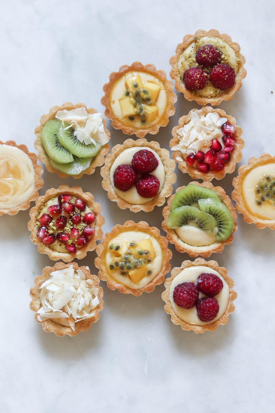 """<p>These adorable, bite-sized tarts are made with a shortbread crust and smooth pastry cream. Choose whatever summer toppings you like best: passionfruit, fresh berries, toasted coconut, or even lemon curd. </p><p><strong>Get the recipe at <a href=""""https://www.carrotandcrumb.com/blog/summer-tarts?rq=pie"""" rel=""""nofollow noopener"""" target=""""_blank"""" data-ylk=""""slk:Carrot and Crumb"""" class=""""link rapid-noclick-resp"""">Carrot and Crumb</a>. </strong></p><p><a class=""""link rapid-noclick-resp"""" href=""""https://go.redirectingat.com?id=74968X1596630&url=https%3A%2F%2Fwww.walmart.com%2Fsearch%2F%3Fquery%3Dtart%2Btins&sref=https%3A%2F%2Fwww.thepioneerwoman.com%2Ffood-cooking%2Fmeals-menus%2Fg36558208%2Fsummer-pie-recipes%2F"""" rel=""""nofollow noopener"""" target=""""_blank"""" data-ylk=""""slk:SHOP TART TINS"""">SHOP TART TINS</a></p>"""