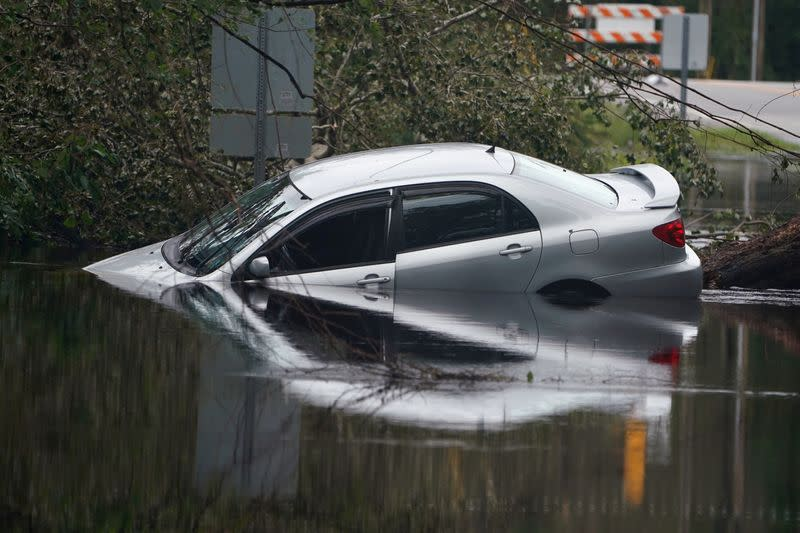 FILE PHOTO: Partially submerged car is pictured on flooded street after Hurricane Florence struck Piney Green