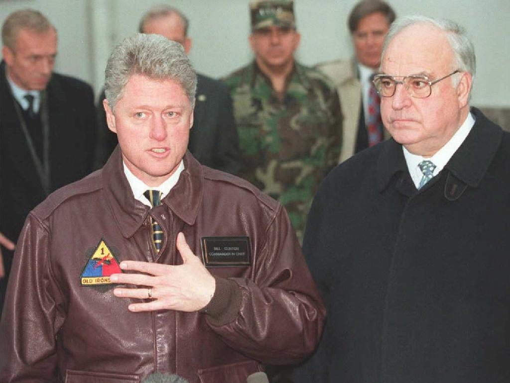 Bill Clinton's time at the White House overlapped with Helmut Kohl's in the 1990s when a reunified Germany led efforts to expand the EU and NATO (AFP Photo/LUKE FRAZZA)
