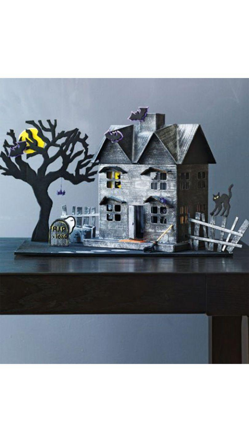 """<p>This spook-tacular haunted house will make a major statement as a centerpiece on a kitchen or dining room table. </p><p><em><a href=""""https://www.womansday.com/home/crafts-projects/how-to/a5968/craft-project-haunted-house-123861/"""" rel=""""nofollow noopener"""" target=""""_blank"""" data-ylk=""""slk:Get the Haunted House tutorial"""" class=""""link rapid-noclick-resp"""">Get the Haunted House tutorial</a>.</em></p><p><strong>What You'll Need</strong>: <a href=""""https://www.amazon.com/Darice-Piece-Paper-Mache-House/dp/B016O8W4V4/ref=sr_1_2?dchild=1&keywords=paper+mache+house&qid=1595005180&sr=8-2&tag=syn-yahoo-20&ascsubtag=%5Bartid%7C10070.g.1279%5Bsrc%7Cyahoo-us"""" rel=""""nofollow noopener"""" target=""""_blank"""" data-ylk=""""slk:Paper mache house"""" class=""""link rapid-noclick-resp"""">Paper mache house</a> ($21, Amazon); <a href=""""https://www.amazon.com/Cavallini-Co-Trick-Treat-Decorative/dp/1635442397/ref=sr_1_11?dchild=1&keywords=halloween+decorative+paper&qid=1595005226&sr=8-11&tag=syn-yahoo-20&ascsubtag=%5Bartid%7C10070.g.1279%5Bsrc%7Cyahoo-us"""" rel=""""nofollow noopener"""" target=""""_blank"""" data-ylk=""""slk:decorative paper"""" class=""""link rapid-noclick-resp"""">decorative paper</a> ($9, Amazon); <a href=""""https://www.amazon.com/heartybay-Brushes-Watercolor-Painting-Professional/dp/B07D4CX8J3/ref=sr_1_1_sspa?dchild=1&keywords=paint+brushes&qid=1595005274&sr=8-1-spons&psc=1&spLa=ZW5jcnlwdGVkUXVhbGlmaWVyPUEzOE5MUklKUUQ5SkxOJmVuY3J5cHRlZElkPUEwNDY0OTIwMllJVExBWUtYMUk3SCZlbmNyeXB0ZWRBZElkPUEwNTAwNTYwMjZNN0dYUTRHTFdJVCZ3aWRnZXROYW1lPXNwX2F0ZiZhY3Rpb249Y2xpY2tSZWRpcmVjdCZkb05vdExvZ0NsaWNrPXRydWU%3D&tag=syn-yahoo-20&ascsubtag=%5Bartid%7C10070.g.1279%5Bsrc%7Cyahoo-us"""" rel=""""nofollow noopener"""" target=""""_blank"""" data-ylk=""""slk:paintbrushes"""" class=""""link rapid-noclick-resp"""">paintbrushes</a> ($9, Amazon); <a href=""""https://www.amazon.com/Midwest-Products-Project-Economy-Assorted/dp/B00PPA9CU4/ref=sr_1_1_sspa?dchild=1&keywords=Balsa+wood+variety+pack&qid=1595005525&sr=8-1-spons&psc=1&spLa=ZW5jcnlwdGVkUXVhbGlmaWVyPUFNMTkySUdSOTA5NkcmZW5jcnlw"""