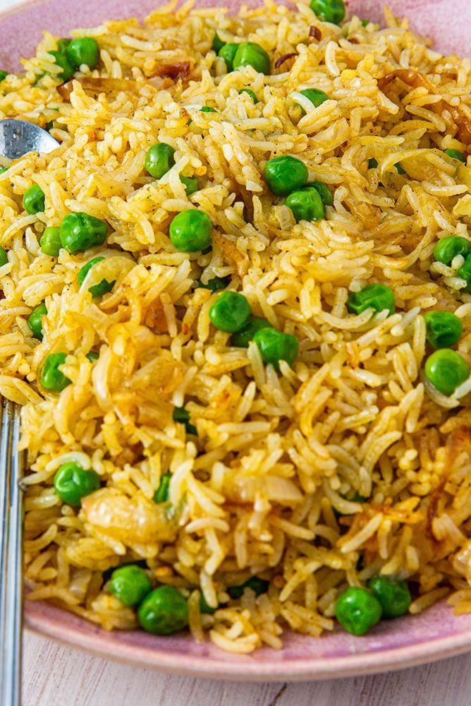 """<p>Don't get us wrong, good ol' boiled rice is nice and all that, but the vibrant colour of pilau rice just adds a bit of something something to our plates. Plus, it's a versatile dish, and you can add a variety of veggies or protein to bulk it out a bit. </p><p>Get the <a href=""""https://www.delish.com/uk/cooking/recipes/a29484612/pilau-rice/"""" rel=""""nofollow noopener"""" target=""""_blank"""" data-ylk=""""slk:Pilau Rice"""" class=""""link rapid-noclick-resp"""">Pilau Rice</a> recipe.</p>"""