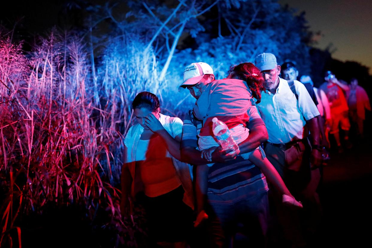 Migrants, part of a caravan traveling to the U.S., walk along the road to Huixtla, near Tapachula, Mexico, on Wednesday. (Photo: Carlos Garcia Rawlins/Reuters)