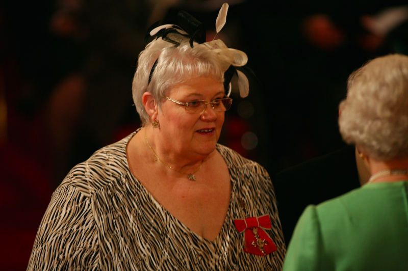Foster carer Penelope Jones receives her MBE from the Queen in 2010 (Picture: PA)