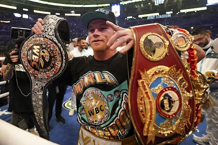 Canelo Alvarez celebrates after defeating Billy Joe Saunders in a unified super middleweight world championship.