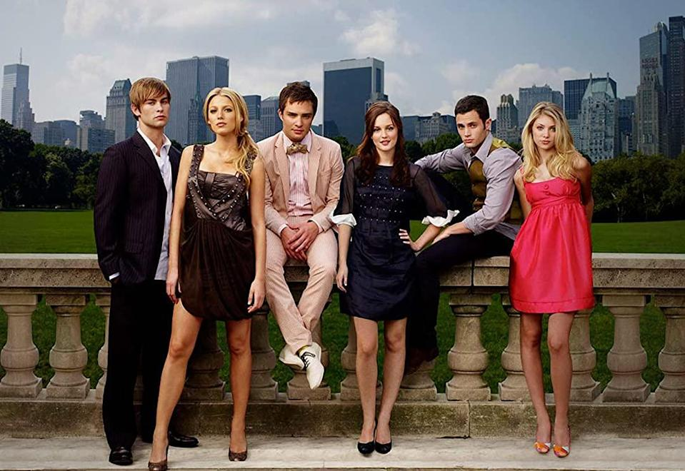 A press clip from Gossip Girl shows the cast sitting on a fancy wall