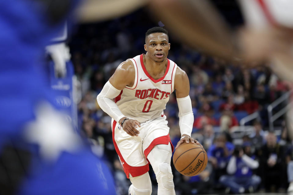Houston Rockets guard Russell Westbrook (0) moves the ball against the Orlando Magic during the first half of an NBA basketball game, Friday, Dec. 13, 2019, in Orlando, Fla. (AP Photo/John Raoux)