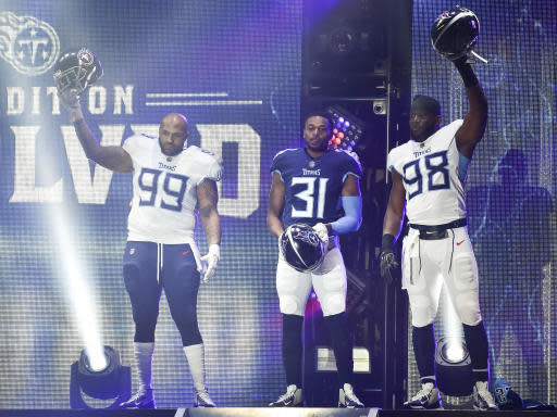 FILE - In this April 4, 2018, file photo, Tennessee Titans defensive tackle Jurrell Casey (99), safety Kevin Byard (31) and linebacker Brian Orakpo (98) show off new uniforms as the NFL football team revealed the redesigned uniforms, in Nashville, Tenn. The NFL draft is heading to Music City. League owners awarded the 2019 draft to Nashville during their annual spring meetings on Wednesday, May 23, 2018, in Atlanta. (Andrew Nelles/The Tennessean via AP, File)