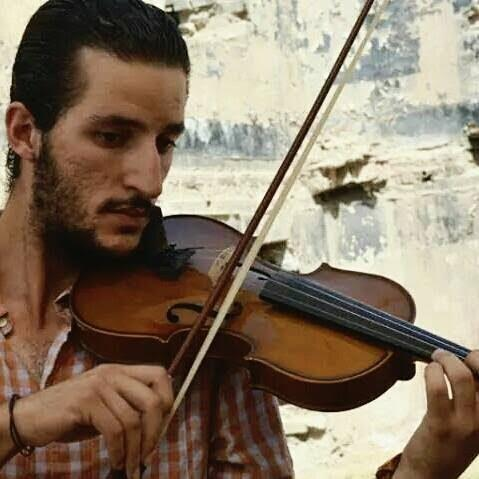 Ameen Mokdad playing his violin - Credit: Ameen Mokdad