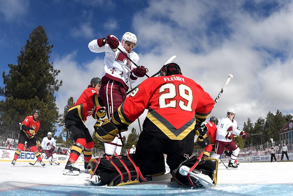 <p>Valeri Nichushkin #13 of the Colorado Avalanche jumps in front of goaltender Marc-Andre Fleury #29 of the Vegas Golden Knights who makes a save during the first period of the 2021 Bridgestone NHL Outdoors Saturday on the 18th fairway of the Edgewood Tahoe Resort, at the south shore of Lake Tahoe on February 20, 2021 in Stateline, Nevada. (Photo by Brian Babineau/NHLI via Getty Images)</p>