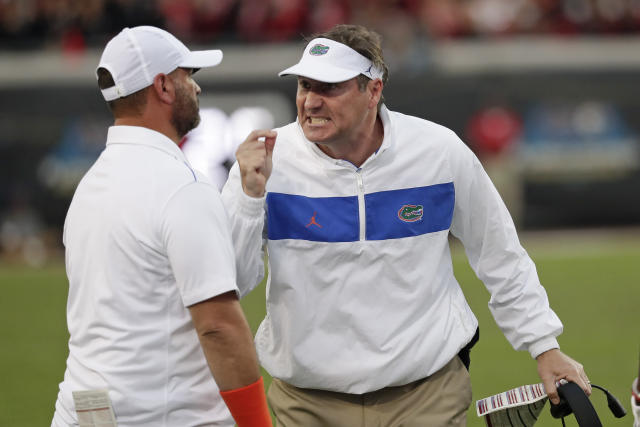 Florida head coach Dan Mullen, right, yells at receivers coach Billy Gonzales during the second half of an NCAA college football game against Georgia, Saturday, Nov. 2, 2019, in Jacksonville, Fla. (AP Photo/John Raoux)