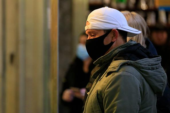 People are seen wearing face masks while shopping at the Queen Victoria Market in Melbourne, Australia.