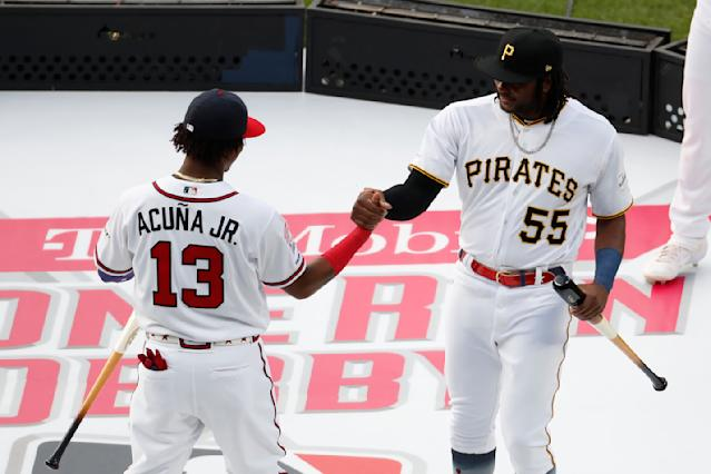 Ronald Acuna Jr., of the Atlanta Braves, and Josh Bell, of the Pittsburgh Pirates, are introduced during the Major League Baseball Home Run Derby, Monday, July 8, 2019, in Cleveland. The MLB baseball All-Star Game will be played Tuesday. (AP Photo/Ron Schwane)