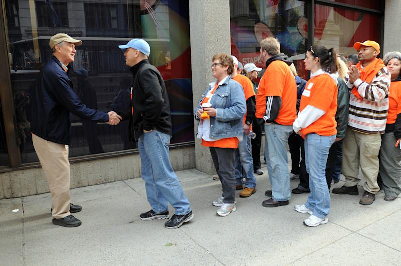 BOSTON, MA - OCTOBER 06: (L) Frank Blake, CEO Home Depot, greets Team Depot associates as the prepare for the renovation of the New England Center for Homeless Veterans by The Home Depot Foundation on October 6, 2011 in Boston, Massachusetts. (Photo by Darren McCollester/WireImage for The Home Depot Foundation)