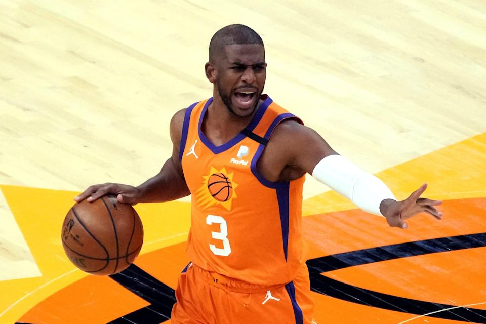 Phoenix Suns guard Chris Paul (3) calls out a play against the New York Knicks during the first half of an NBA basketball game Friday, May 7, 2021, in Phoenix. (AP Photo/Rick Scuteri).