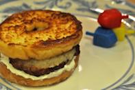 """<p>Make this gut-busting sammie at your own risk. It calls on all the Hanukkah staples: a doughnut bun, a latke """"patty,"""" and dressings of applesauce and sour cream. <a href=""""https://www.yahoo.com/food/hallelujah-its-the-hanukkah-miracle-sandwich-105281556016.html"""" data-ylk=""""slk:Get the recipe here.;outcm:mb_qualified_link;_E:mb_qualified_link;ct:story;"""" class=""""link rapid-noclick-resp yahoo-link"""">Get the recipe here.</a> <i>(Photo: Dan Pashman)</i></p>"""