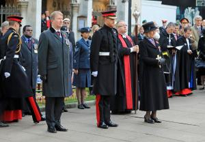 Prince Harry stands at attention at Field of Remembrance ceremony