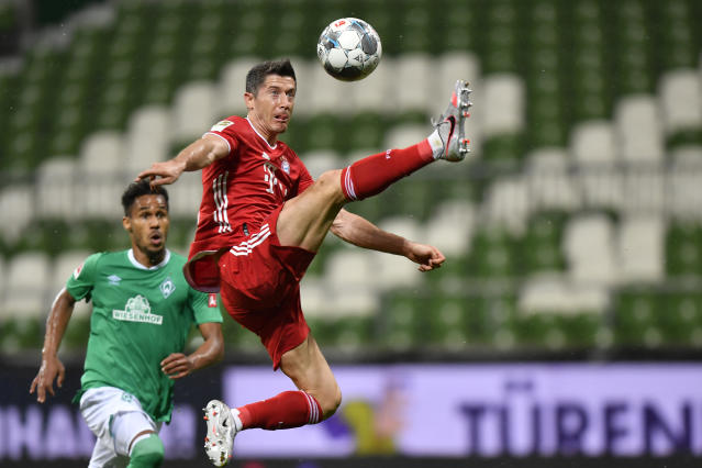 Bayern's Robert Lewandowski controls the ball during the German Bundesliga soccer match between Werder Bremen and Bayern Munich in Bremen, Germany, Tuesday, June 16, 2020. Because of the coronavirus outbreak all soccer matches of the German Bundesliga take place without spectators. (AP Photo/Martin Meissner, Pool)