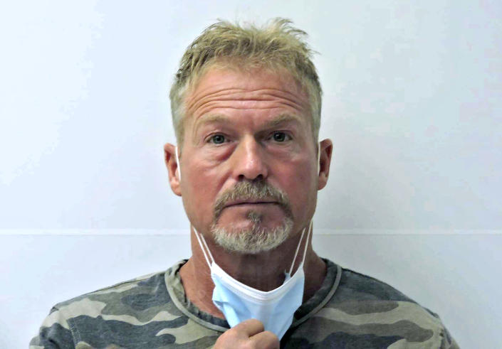 """FILE - This undated file photo provided by the Chaffee County (Colo.) Sheriff's Office shows Barry Morphew in Salida, Colo. According to a court document released Monday, Sept. 20, 2021, investigators allege that Morphew, charged with killing his missing wife, decided to """"hunt and control"""" her like an animal after she insisted on leaving him and later changed his statements as evidence in the case developed. (Chaffee County Sheriff's Office via AP, File)"""