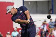 Team USA's Bryson DeChambeau hits a drive on the second hole during a four-ball match the Ryder Cup at the Whistling Straits Golf Course Friday, Sept. 24, 2021, in Sheboygan, Wis. (AP Photo/Jeff Roberson)