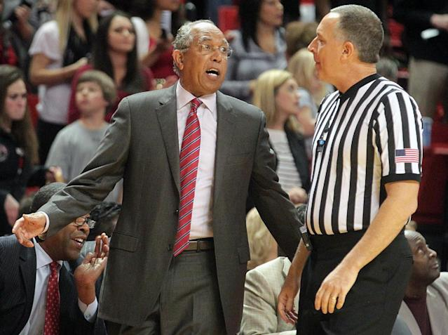 Texas Tech's coach Tubby Smith disagrees with a foul called by the referee during an NCAA college basketball game in Lubbock, Texas, Tuesday, Feb, 25, 2014. (AP Photo/Lubbock Avalanche-Journal, Stephen Spillman)