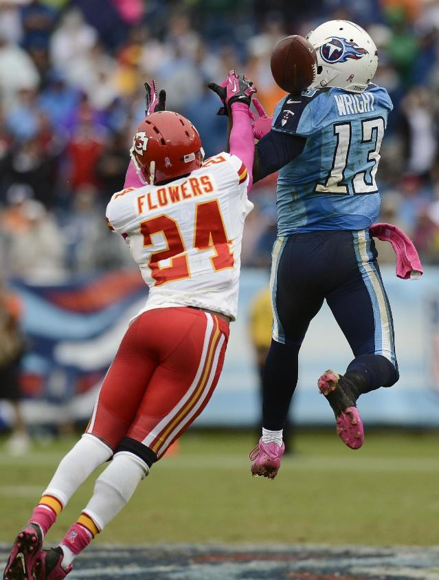 Kansas City Chiefs cornerback Brandon Flowers (24) breaks up a pass intended for Tennessee Titans wide receiver Kendall Wright (13) late in the fourth quarter of an NFL football game on Sunday, Oct. 6, 2013, in Nashville, Tenn. Chiefs defensive back Quintin Demps intercepted the deflected pass. (AP Photo/Mark Zaleski)
