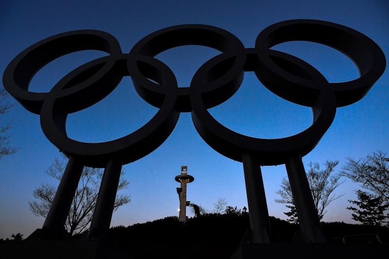 The ski jump tower is seen behind the the Olympic rings ahead of the Pyeongchang 2018 Winter Olympic Games in PyeongchangMore