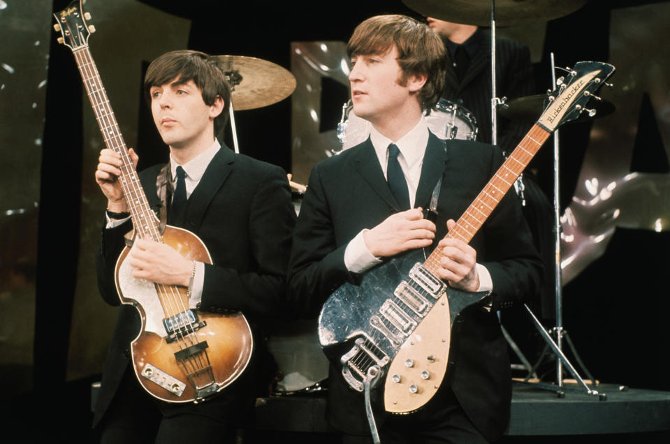 Paul McCartney and John Lennon hold their guitars while on the set of The Ed Sullivan Show at the CBS television studios in Manhattan, where the Fab Four are performing their nationwide television debut.