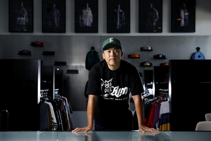 "The Hundreds cofounder Bobby Kim at the company's office in Vernon. <span class=""copyright"">(Christina House / Los Angeles Times)</span>"