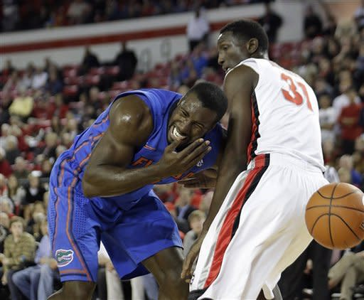 Florida center Patric Young, left, reacts after colliding with Georgia forward Brandon Morris (31) in the first half of an NCAA college basketball game on Wednesday, Jan. 23, 2013, in Athens, Ga. (AP Photo/John Bazemore)