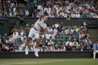 Switzerland's Roger Federer serves to Britain's Cameron Norrie during the men's singles third round match on day six of the Wimbledon Tennis Championships in London, Saturday July 3, 2021. (AP Photo/Alastair Grant)