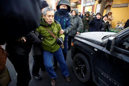 A supporter of prominent rights lawyer Wang Quanzhang is detained outside the courthouse where Wang's trial is held, in Tianjin, China December 26, 2018.  REUTERS/Thomas Peter