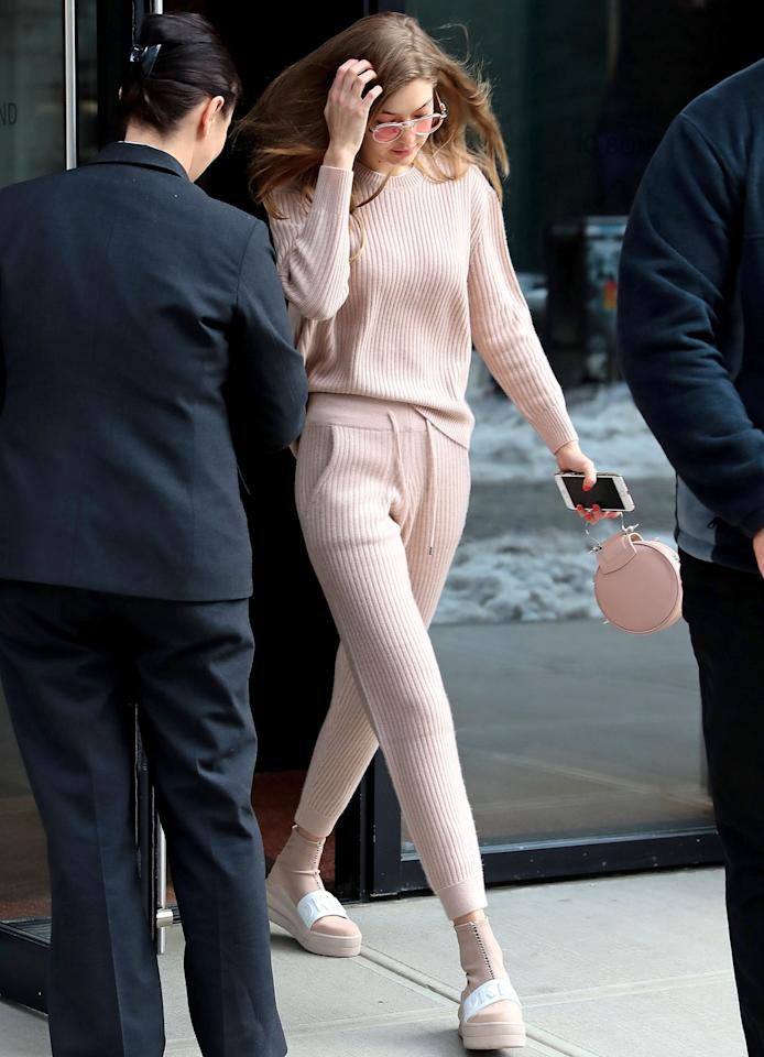 <p>Hadid was seeing life through rose-colored glasses (literally) in N.Y.C., when she stepped out in this casual-chic, all-pink ensemble. The model paired a cozy cashmere sweatsuit with a round pink bag and DKNY platforms, providing the ultimate in off-duty dressing inspiration. </p>