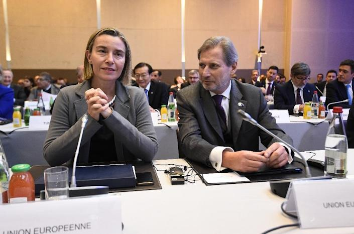EU Foreign Policy Chief Federica Mogherini and EU Commissioner Johannes Hahn attend the Mideast peace conference in Paris, on January 15, 2017 (AFP Photo/bertrand GUAY)