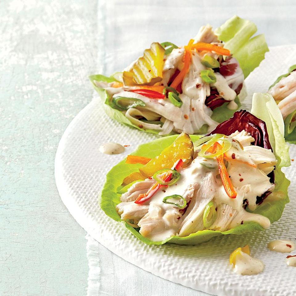 """<p><strong>Recipe: <a href=""""https://www.southernliving.com/syndication/slow-cooker-chicken-lettuce-cups"""" rel=""""nofollow noopener"""" target=""""_blank"""" data-ylk=""""slk:Slow-Cooker Chicken Lettuce Cups"""" class=""""link rapid-noclick-resp"""">Slow-Cooker Chicken Lettuce Cups</a></strong></p> <p>Chicken served in lettuce cups is a lightened-up dinner that can still be prepared in the slow cooker. </p>"""