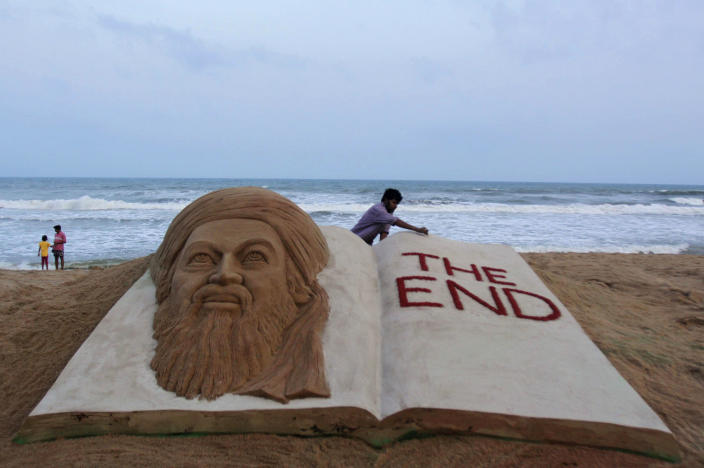 Indian sand artist Sudarshan Pattnaik gives finishing touches to a sand sculpture to mark the killing of Osama bin Laden at the golden sea beach at Puri, Orissa, India, Monday, May 2, 2011. Osama bin Laden, the mastermind behind the Sept. 11, 2001, terror attacks that killed thousands of people, was slain in his luxury hideout in Pakistan early Monday in a firefight with U.S. forces, ending a manhunt that spanned a frustrating decade.