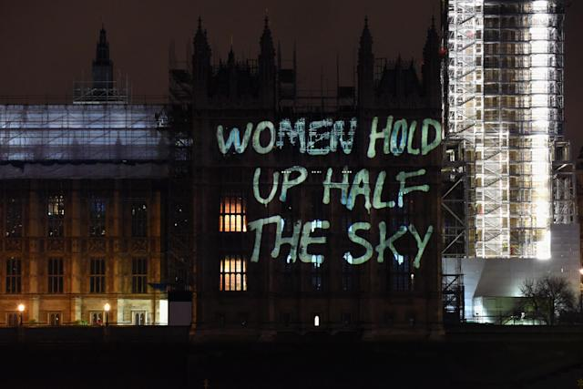 <p>Messages are projected onto the Houses of Parliament to mark the start of International Women's Day on March 8, 2018, in London, England. (Photo: Nicky J Sims/Getty Images for GladLife Ltd) </p>