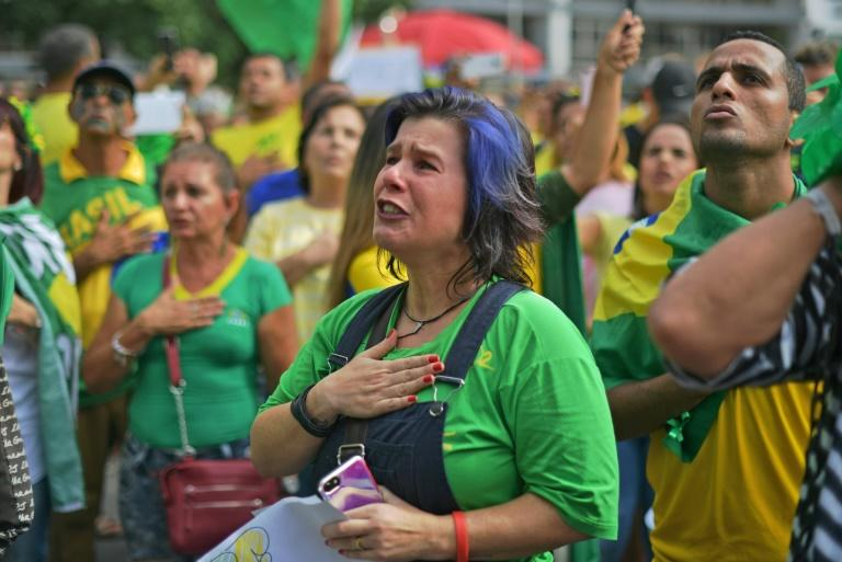 A backer of Brazilian President Jair Bolsonaro at a demonstration seen as a gauge of support for the ultra-conservative president, whose popularity has plunged amid rising unemployement and a freeze on education spending