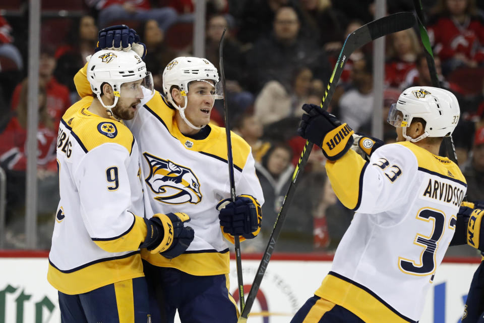 Nashville Predators center Kyle Turris (8) celebrates with left wing Filip Forsberg (9), of Sweden, as right wing Viktor Arvidsson (33), also of Sweden, joins the group after Forsberg scored a goal during the first period of an NHL hockey game against the New Jersey Devils, Thursday, Jan. 30, 2020, in Newark, N.J. (AP Photo/Kathy Willens)