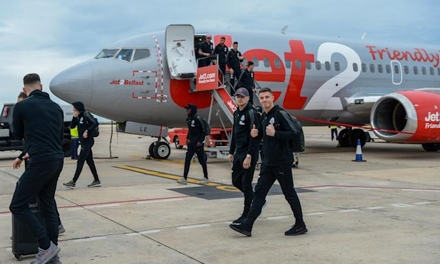Newcastle Players arrive at Murcia airport before their warm-weather training camp in Spain last week.