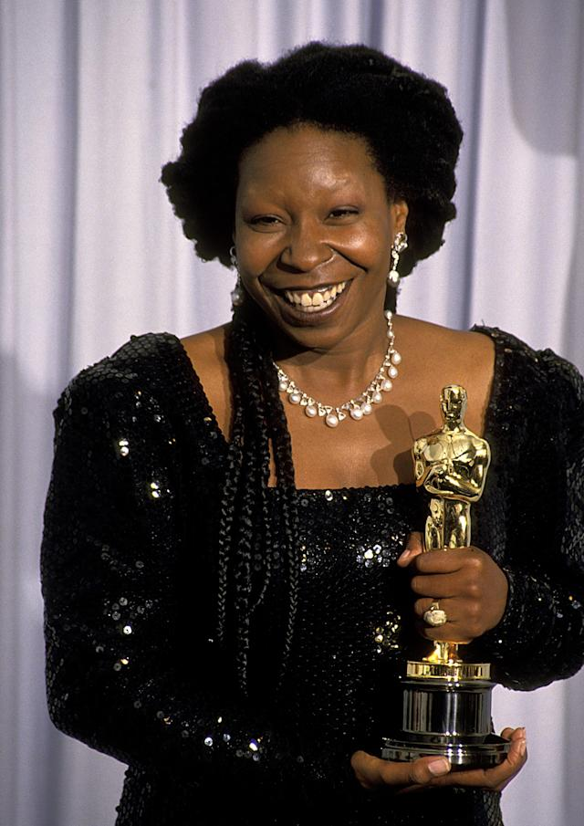 Whoopi Goldberg holds her Oscar on the night she won it. (Photo: Ron Galella/WireImage)