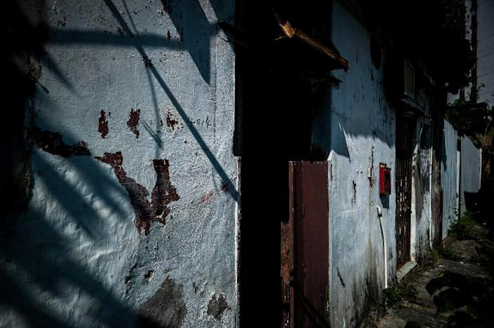 Nga Tsin Wai village was built in 1354 and the original walls and battlements have disappeared, leaving a collection of around 50 ramshackle houses, shops and a temple (AFP Photo/Philippe Lopez)
