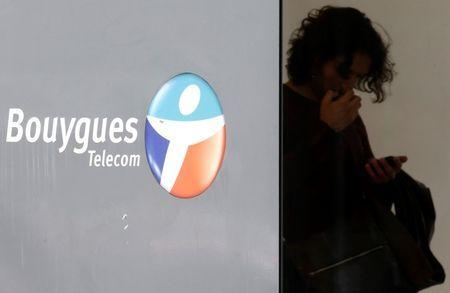 A man checks his mobile device at a French telecom operator Bouygues Telecom store in Paris, France, June 23, 2015. REUTERS/Christian Hartmann