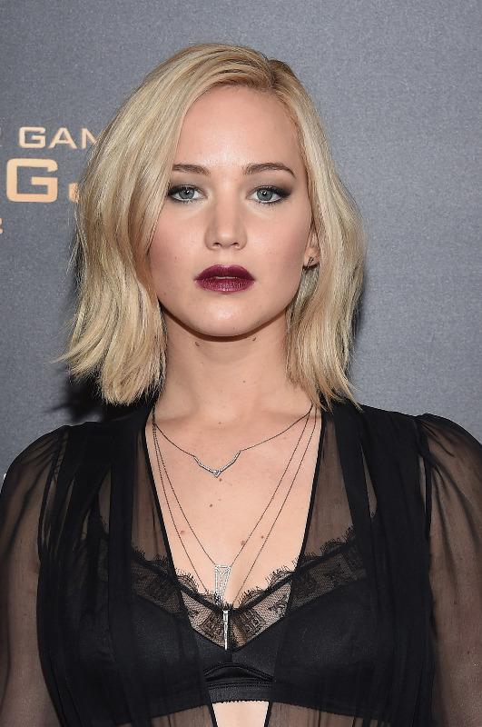 "<p>Lawrence's makeup artist, Jillian Dempsey, channeled the '90s with this intense makeup look, pairing deep plum lips with liner and shadow. To DIY, Yahoo Beauty Editor in Chief Bobbi Brown recommends <a href=""https://www.yahoo.com/beauty/double-line-your-eyes-to-make-them-pop-126451239343.html?soc_src=mail&soc_trk=ma"" data-ylk=""slk:double lining;outcm:mb_qualified_link;_E:mb_qualified_link;ct:story;"" class=""link rapid-noclick-resp yahoo-link"">double lining</a> your eyes to make them pop. ""Layering powder and gel liner will create an intense, bold line with added depth,"" she says. ""I like to make the line thicker as I move across the eye. If the line is thickest at the outer corners, it opens and lifts your eyes."" Start with a damp brush for the powder and apply the gel after. Try <a href=""http://www.sephora.com/terracotta-khol-loose-powder-eyeliner-P116908?bvrrp=8723/reviews/product/27/P116908.htm"" rel=""nofollow noopener"" target=""_blank"" data-ylk=""slk:Guerlain Terracotta Kohl Loose Powder Eyeliner"" class=""link rapid-noclick-resp"">Guerlain Terracotta Kohl Loose Powder Eyeliner</a> ($40). (<i>Photo: Getty)</i><br></p>"
