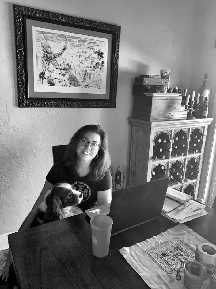Maria C. Alonso was photographed at home, with her dog.
